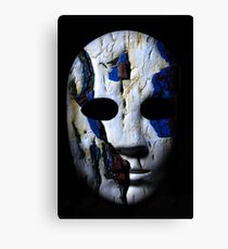 Textured mask with cracked rough wood  painted surface, neutral expression on dark background. Canvas Print