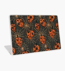 Orange Leaves With Holes And Spiderwebs Laptop Skin