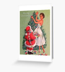 Santa Claus is helping woman to decorate Christmas tree Greeting Card