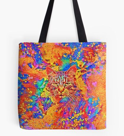 A colorful dramatic Cat is sitting on a colorful quilt Tote Bag