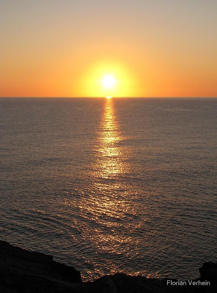 sunrise over ocean by Florian Verhein