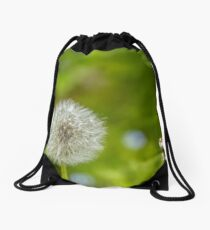 Dandelion in green background Drawstring Bag