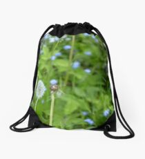 Dandelion growing in the grass Drawstring Bag