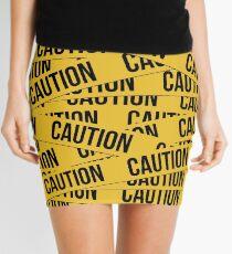 Minifalda Caution