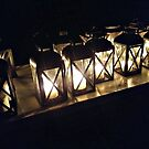 Lit Lanterns in a Row by Jane Neill-Hancock