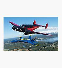 A U.S. Navy F/A-18 Hornet aircraft assigned to the Blue Angels  flies alongside Younkin Air Show's performer Matt Younkin Photographic Print