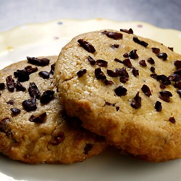 Chocolate chips cookies on a plate by junpinzon