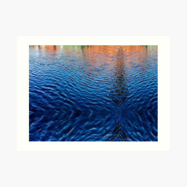 Blue water with orange reflections Art Print