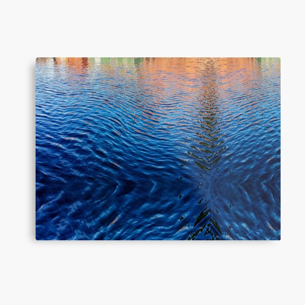 Blue water with orange reflections Metal Print
