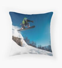 Snowboarder Jumping on a snowy mountain Throw Pillow