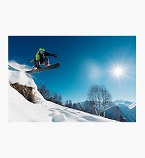 Snowboarder Jumping on a snowy mountain Photographic Print