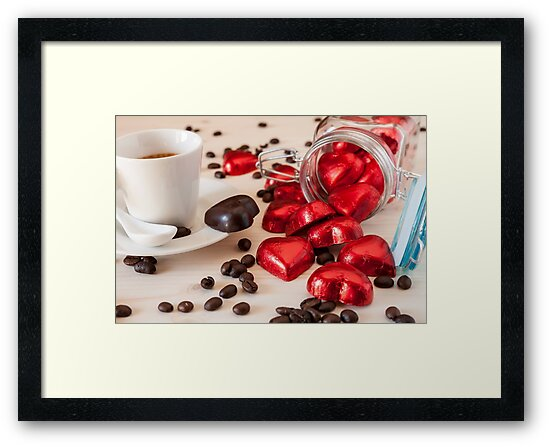 Red chocolate hearts in a glass jar and an espresso coffee by Luigi Morbidelli