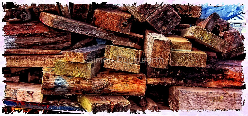 Wood pile at the docks by Simon Duckworth