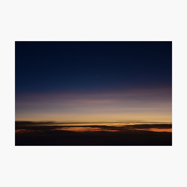 Moon rising above the clouds; sunset above clouds; sunset; moon Photographic Print