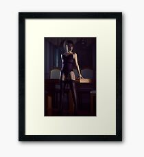 Sensual portrait of a woman in a corset and stockings leaning against a table in a bold pose art photo print Framed Print