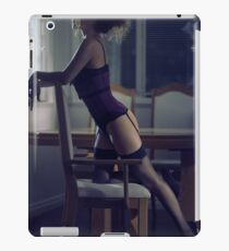 Boudoir portrait of sexy young woman in corset and stockings leaning against chair in dark room art photo print iPad Case/Skin