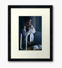 Sensual portrait of a woman in mens shirt and sexy corset sitting by the window with thoughtful expression art photo print Framed Print