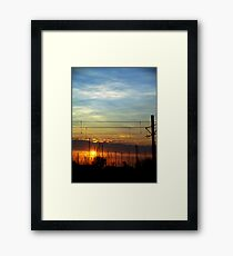 Sunset at the pier Framed Print