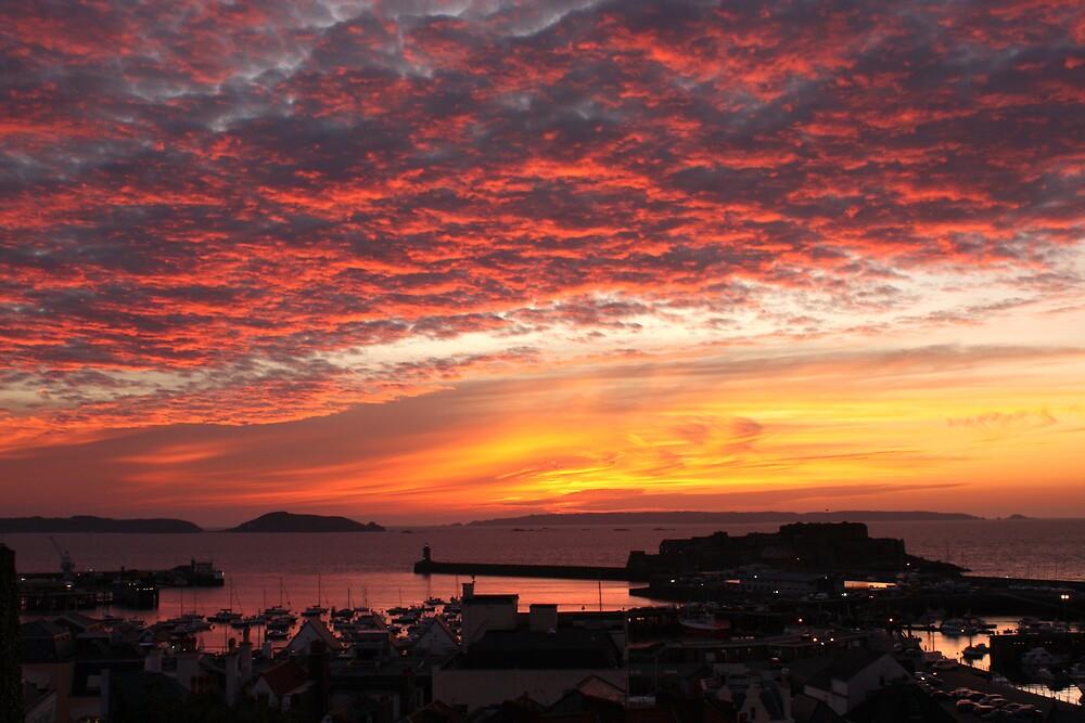 Sunrise over St Peter Port by Karen Millard