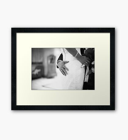 Groom holding bottom of bride black and white wedding photograph Framed Print