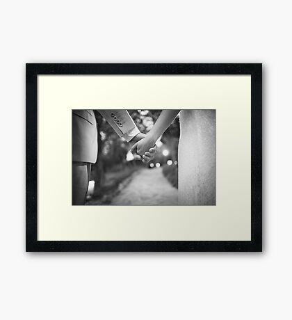 Groom holding hands with bride black and white wedding photograph Framed Print