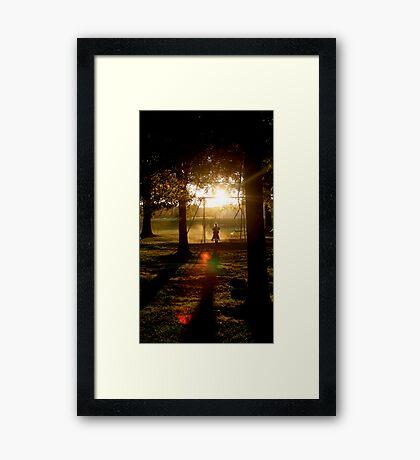 Shadow Swinging Framed Print