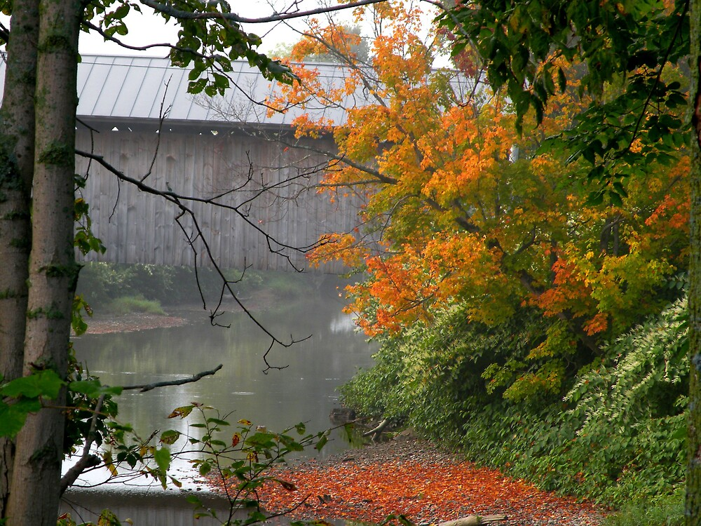 Covered Bridge Through Early Morning Fog by Jean Snide