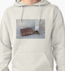 discarded old cardboard suitcase near a gutter in a street  Pullover Hoodie