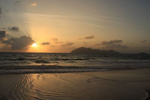 Sunrise of ripple of water by David  Geerlings