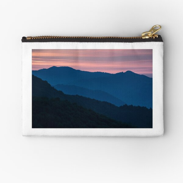 reddish sky at dawn in mountains Zipper Pouch
