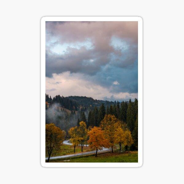 winding road through forest in autumn evening Sticker