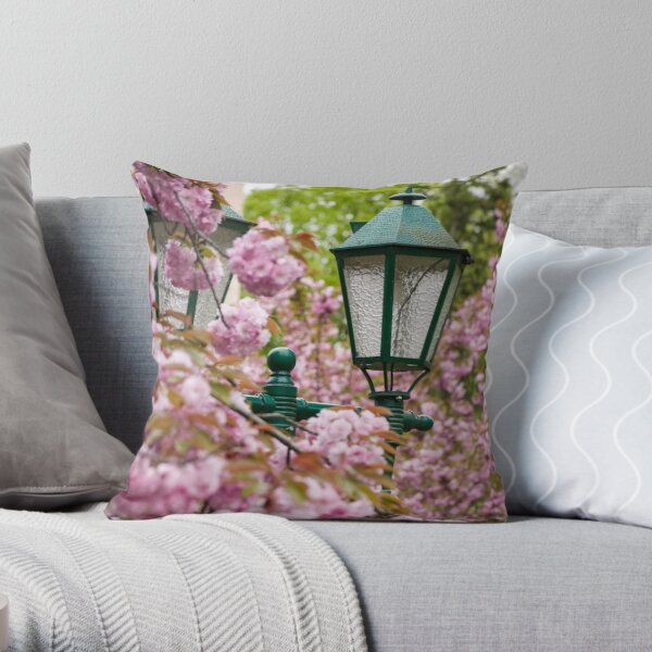 green lantern among cherry blossom Throw Pillow