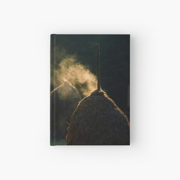 steaming haystack near the forest at sunrise Hardcover Journal