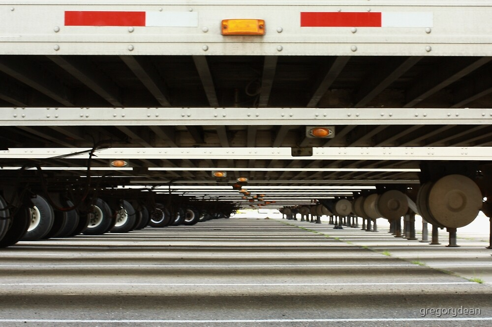 Long view under semi trailers by gregorydean