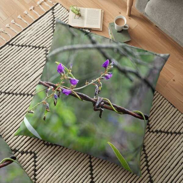 Flowers on barbed wire Floor Pillow