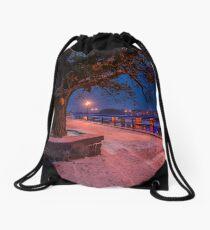 huge tree and lantern on the winter embankment Drawstring Bag