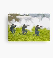 Stylized photo of three Civil War re-enactor soldiers on battlefield firing rifles. Canvas Print