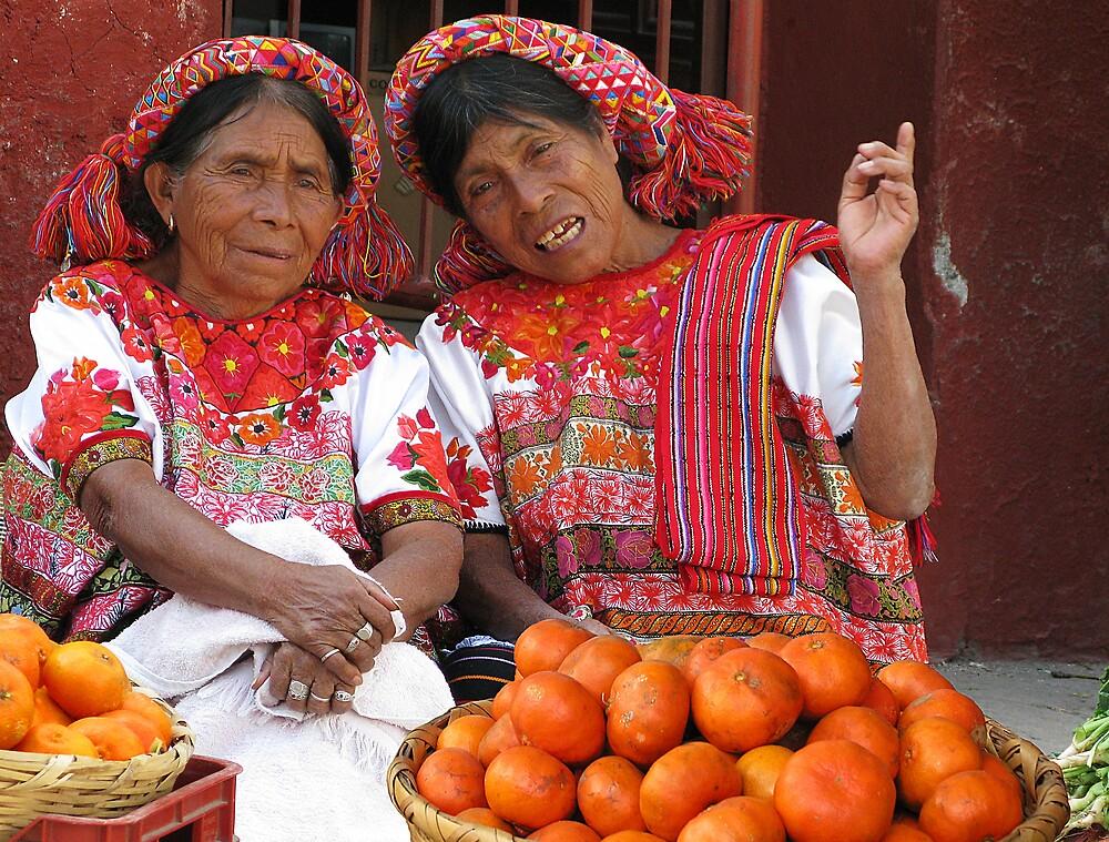 COLOR COORDINATED ORANGE SELLERS - GUATEMALA by Michael Sheridan