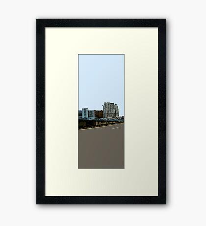 between asphalt & sky Framed Print