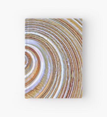 A close up of a cake on Fibonacci table Hardcover Journal
