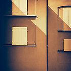White shutters on a facade by Silvia Ganora
