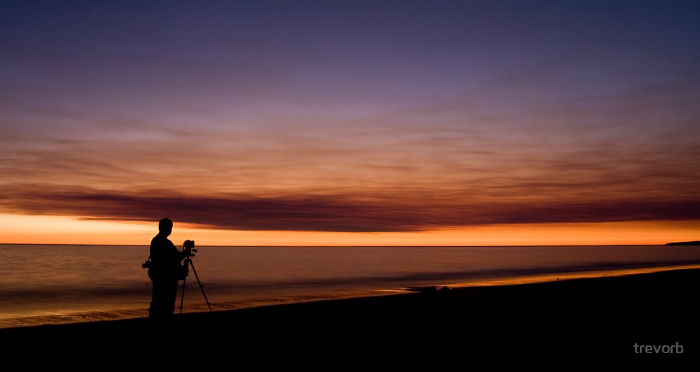 Photographer On Reddell Beach. by trevorb