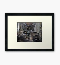 A US soldier stands amid crates and stacks of loot stored by Nazi Germany in Schlosskirche (Castle church), Bavaria, 1945. Framed Print