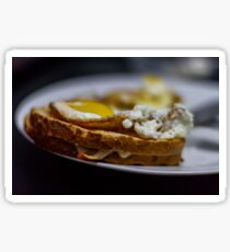 Toast with fried eggs and fried bread on a plate Sticker