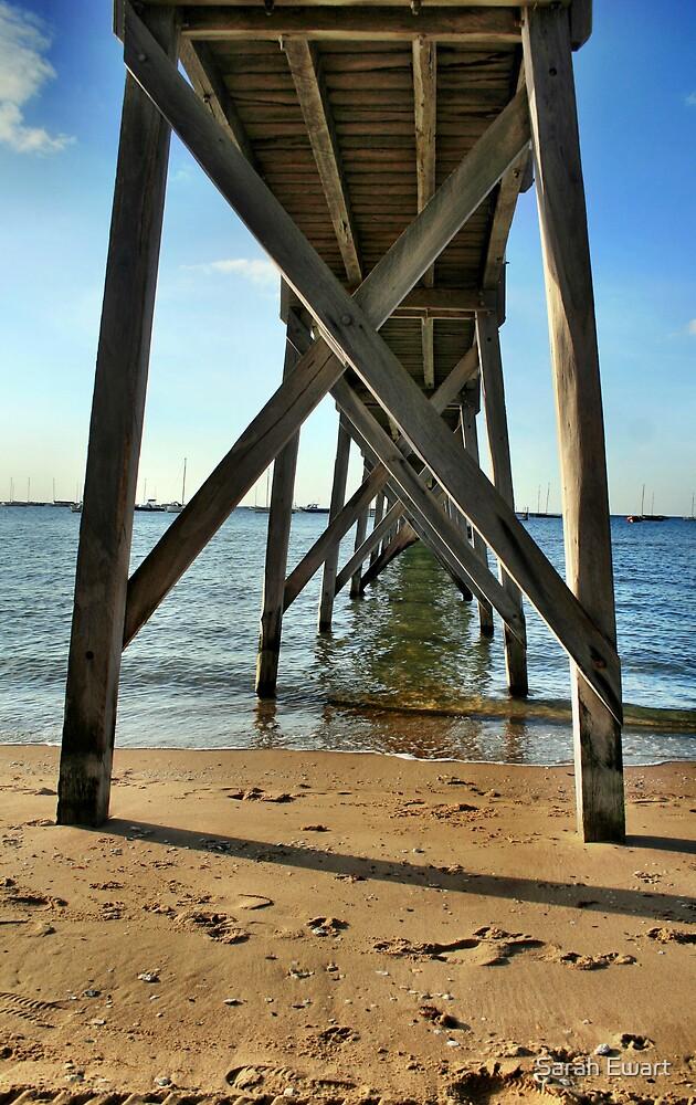 Under the jetty by Sarah Ewart