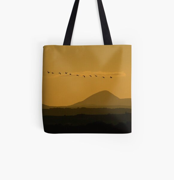 Geese over Derryveagh mountains at Twilight All Over Print Tote Bag
