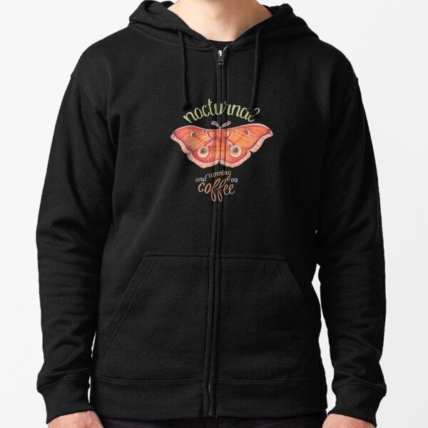 nocturnal orange moth running on coffee on dark background Zipped Hoodie