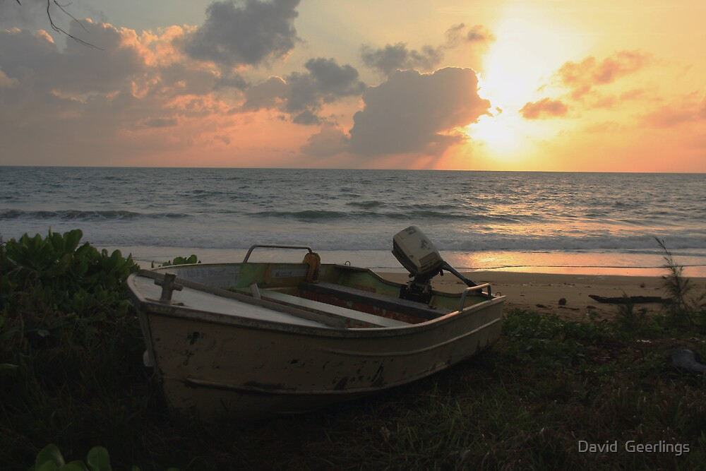 Small boat on the beach at sunrise by David  Geerlings