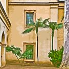Stylized photo of Spanish architecture and palm trees in courtyard of Casa del Prado  in Balboa Park, San Diego CA. by NaturaLight