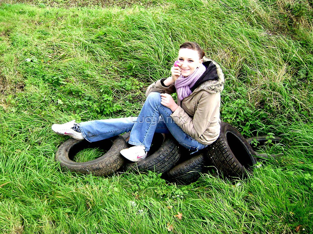 Girl sitting on tyres by LucyAnnx